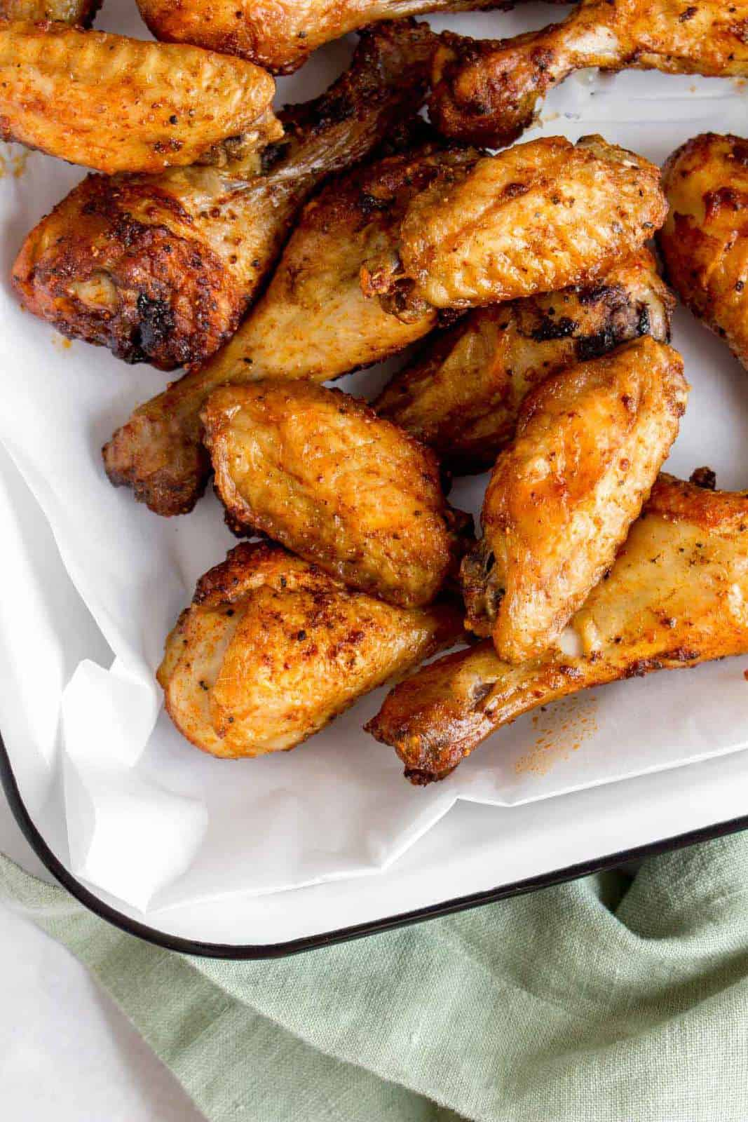 Close up of air fryer chicken wings in a serving platter.
