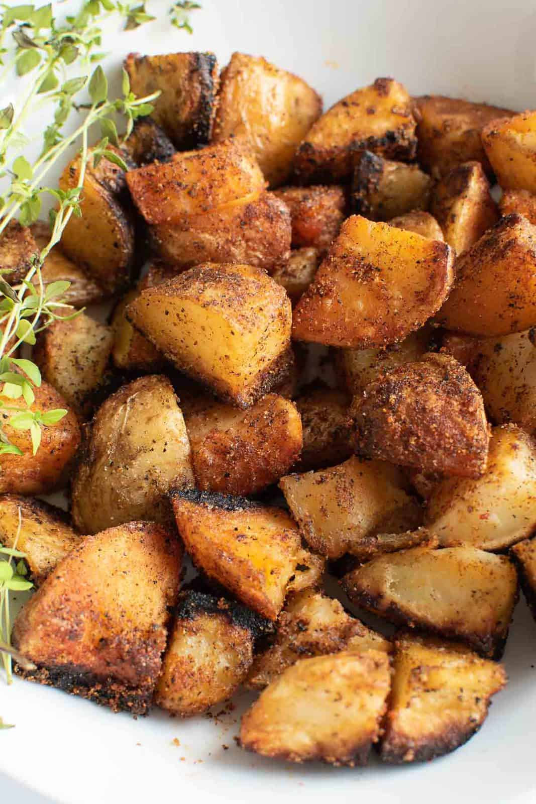 Close up of sauteed potatoes in a bowl.