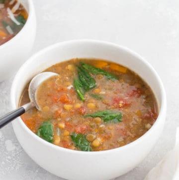 A bowl of Instant Pot lentil soup.