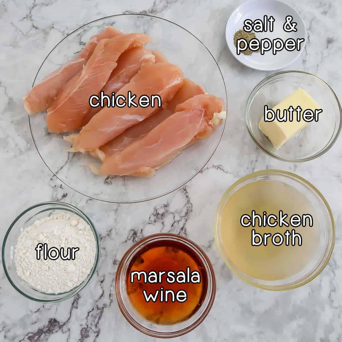 Overhead shot of ingredients- chicken, salt and pepper, butter, chicken broth, marsala wine, and flour.